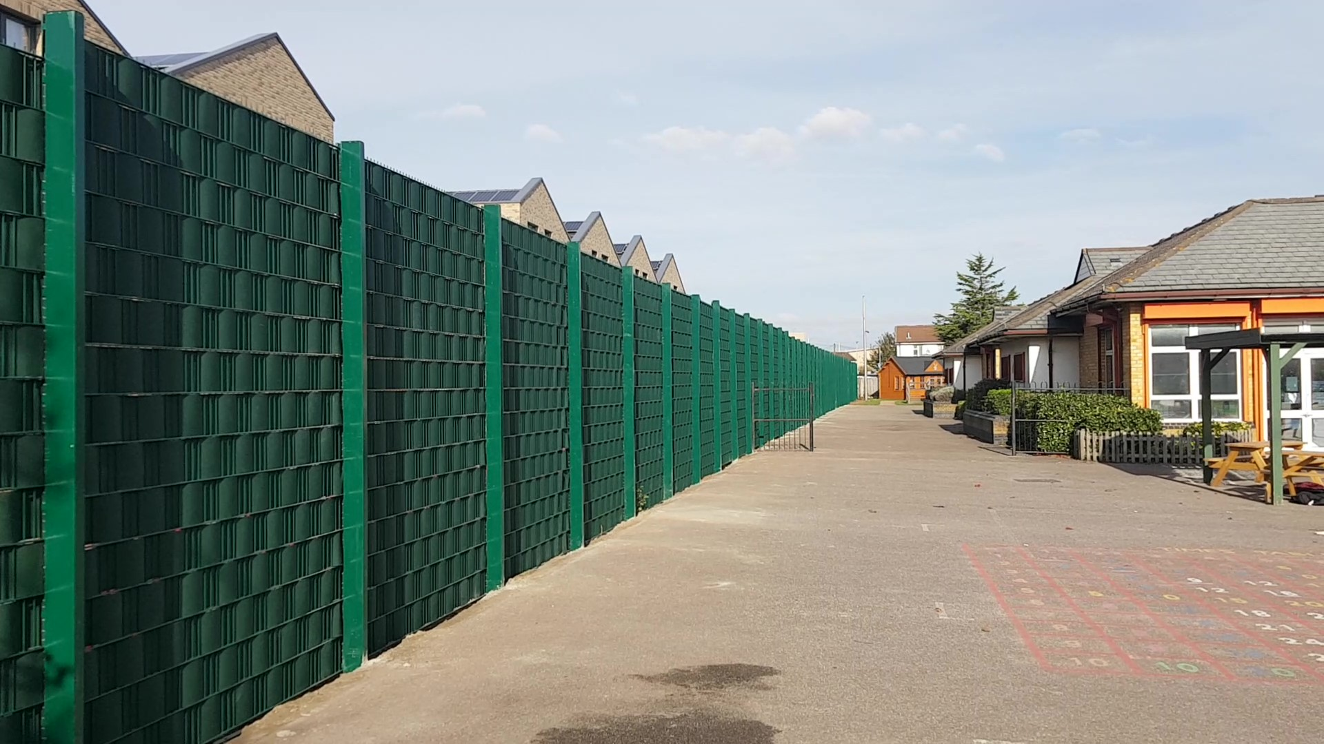 Security Fence with a Woven Recycled Integral Screen